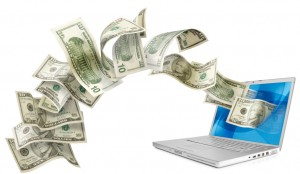 dollars laptop 300x174 Money Making Secrets   How to Leverage Teams of Others to Sell Stuff for You To Create an Online Fortune